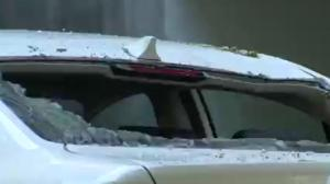 Parked car damaged after furniture thrown from Vancouver apartment