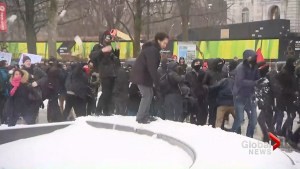 Police keep protesters, counter-protesters apart before snow ball fight erupts as groups march in Quebec City