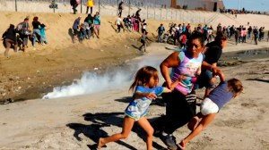 Migrant family known for viral photo of them fleeing from tear gas seek asylum