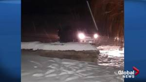 Icy lake saves driver when truck leaves Okanagan highway