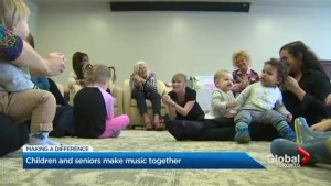Children and seniors in Toronto make music together