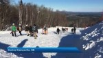Skiers and snowboarders brave the cold for opening weekend at Crabbe Mountain