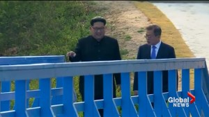 North and South Korean leaders walk on historical border footbridge