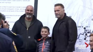 Arnold Schwarzenegger hands out sandwiches, visits the camp fire in northern California