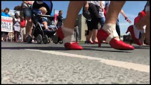 Several hundred don red shoes for Walk a Mile in Their Shoes in Peterborough