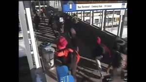 Two boys rushed by group at Edmonton LRT station