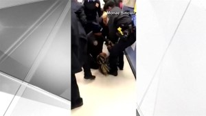 Police officers pull baby from the arms of screaming woman at social services office in NYC