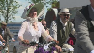 Why was there a parade of finely dressed cyclists in Calgary on Victoria Day?