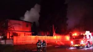 Dog dies and woman displaced in East Vancouver blaze