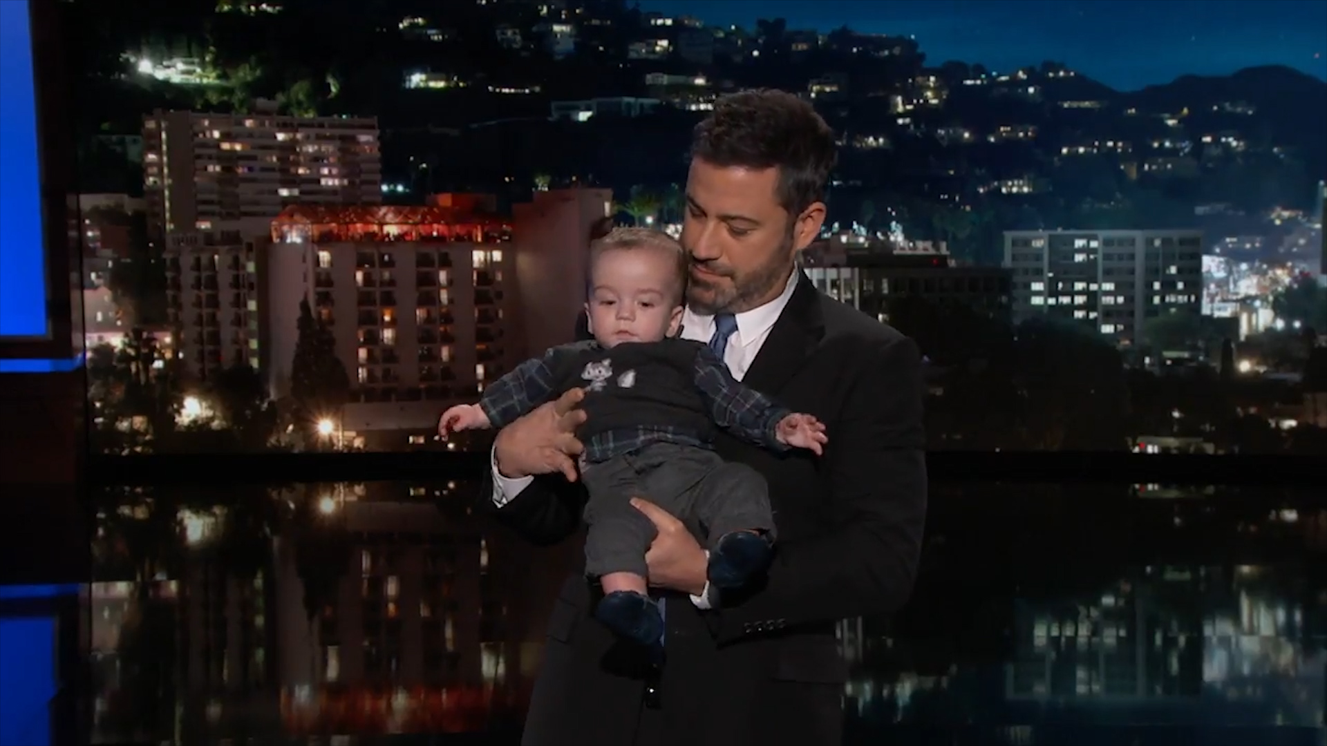 Jimmy Kimmel holds infant son during tearful monologue about children's health care