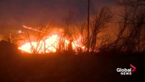 Building engulfed as grass fire burns near Airdrie