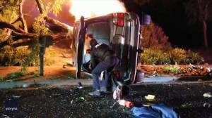 California police officer caught on camera rescuing man from burning vehicle (02:21)