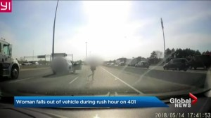 Woman falls from moving SUV onto Highway 401 during rush hour