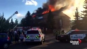 Residents watch as crews battle northeast Edmonton apartment fire