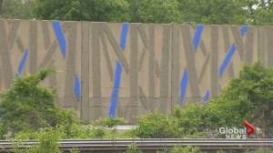 Bleu de bleu: Artist commissioned to paint Montreal sound wall