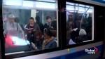 Quebec transport minister, Montreal mayor ride Metro's orange line