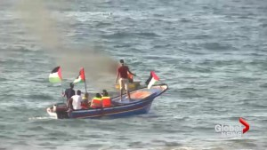 Palestinian activists met with Israeli gunfire as they sailed toward Israeli waters off Gaza Strip