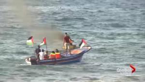 Palestinian activists met with Israeli gunfire as they sailed toward Israeli waters off Gaza Strip