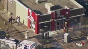 Car careens through Calgary KFC