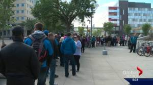 Thousands of Fort McMurray wildfire evacuees wait hours to get pre-paid debit cards