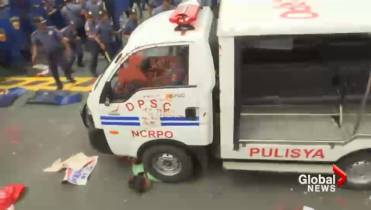 Philippine police van plows into protesters outside US