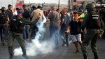 Tear gas fired at Venezuela's Guaido as supporters gather to protest Maduro presidency