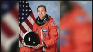 Former astronaut charged with murder after car crash kills two young sisters
