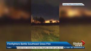 Firefighters battle southeast grass fire