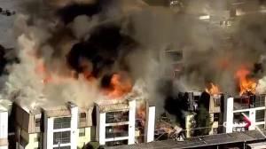 Massive fire engulfs apartment building in Dallas, TX