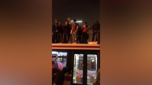 Raptors fans hop on roof of TTC bus, chant in the street after Eastern Conference win