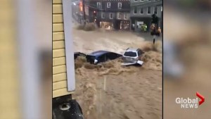 Maryland flash floods carry away vehicles as waters rush through historic town