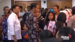 Indonesian president meets plane crash families as search carries into night