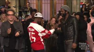 Don Cheadle closes SNL in 'Trump' Soviet Union hockey jersey