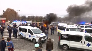 Ambulance drivers in France block square in central Paris protesting reforms