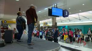 Musicians on airport baggage carousels greet Calgary Stampede visitors: 'An awesome idea!'