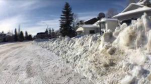 Snow windrows causing problems in Calgary as snow clearing continues