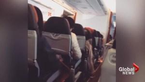 Passenger captures intense shaking during Air Asia flight