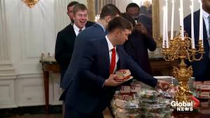 Trump serves up fast food to Clemson Tigers as government shutdown continues