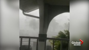 Ferocious wind, rain from Hurricane Irma in Naples, Fla. rips roof tiles off of building