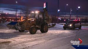 Man arrested after backhoe found carrying ATM in north Edmonton