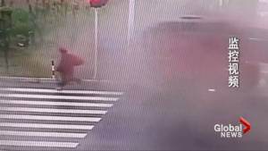 Caught on camera: Out-of-control tractor-trailer nearly crushes cyclist in China
