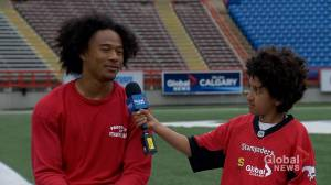 Junior reporter Adam interviews Calgary Stampeders defensive back Royce Metchie