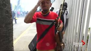 Protesters clash with police as Venezuelan violinist hit with tear gas