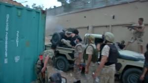 Opposing forces in Libya clash near besieged capital