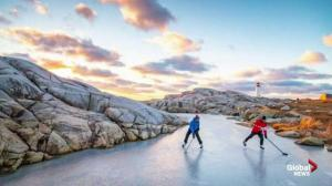 Local photographer's picture of pond hockey by Peggy's Cove goes viral
