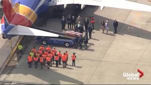 Aerial view as Vietnam veteran's remains returned to U.S.