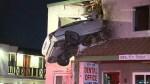 Car soars into second-floor dental office in bizarre California crash