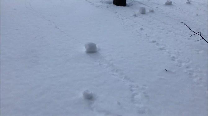 Video captures rare 'snow rolling' phenomenon