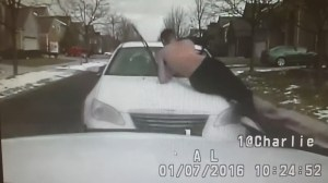 Shirtless Michigan man clings onto hood of brother's car; crashes into police