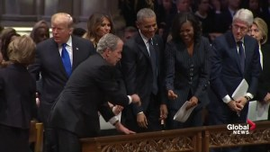 George W. Bush shakes hands with Trump, former presidents